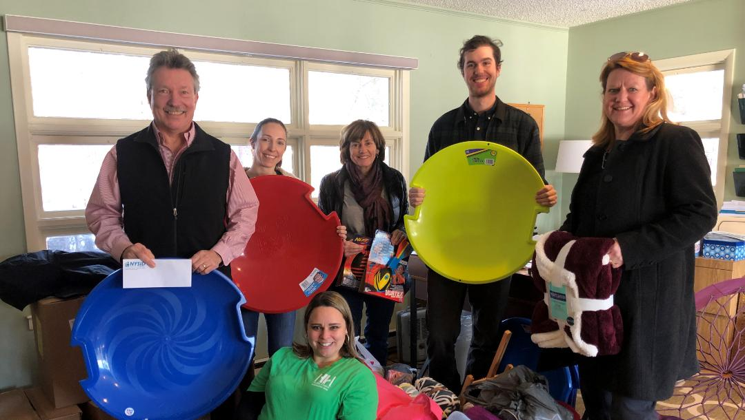 NYSID Staff Delivers Holiday Cheer for Campers and Families at Double H Ranch